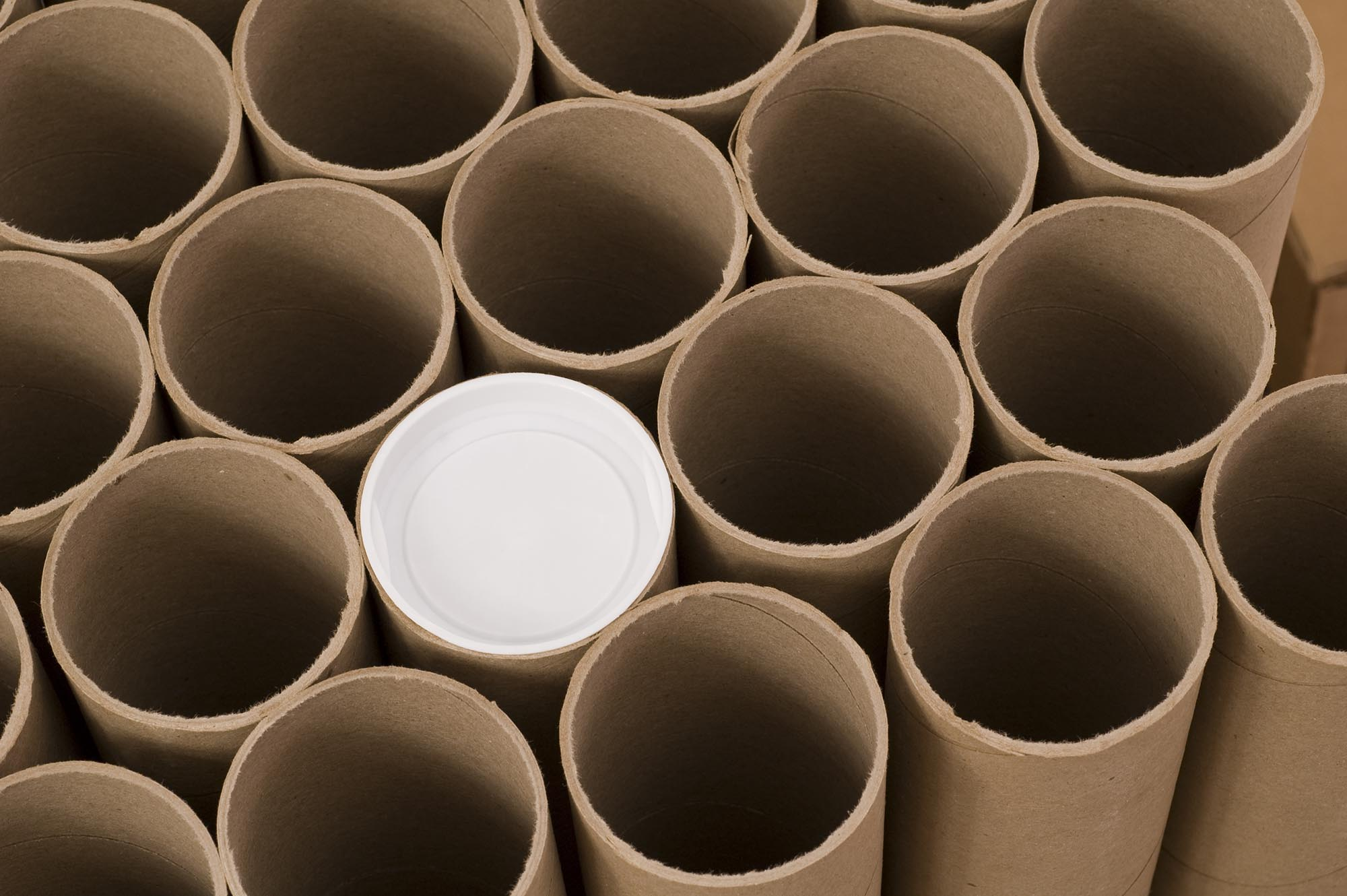 brown mailing tubes and one with cap